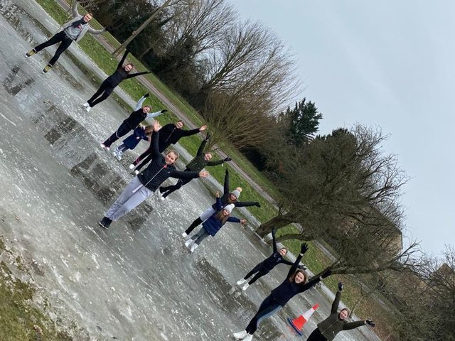 Skaters take advantage of the cold weather by practicing their routines on frozen puddles in Hemel Hempstead