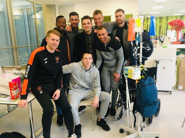Spencer with some of his teammates before he travelled abroad for treatment