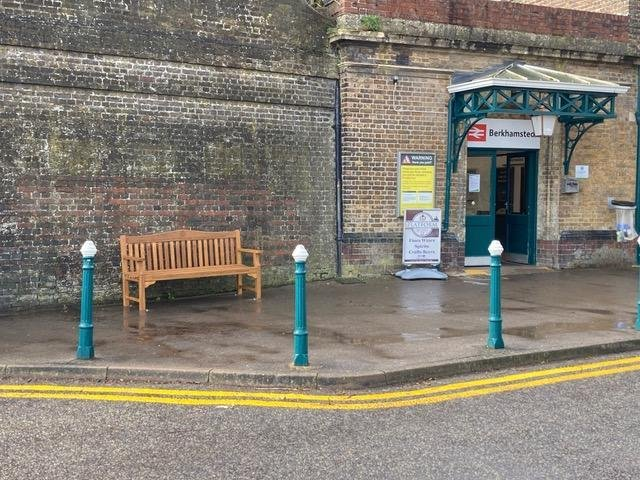 The bench is outside Berkhamsted train station