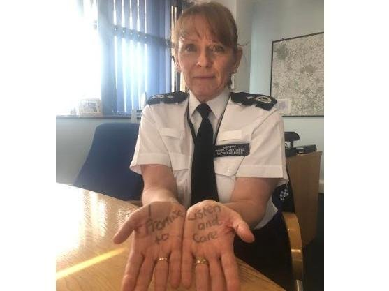 Deputy Chief Constable Michelle Dunn who is showing her support by taking part in the awareness day's Helping Hands campaign