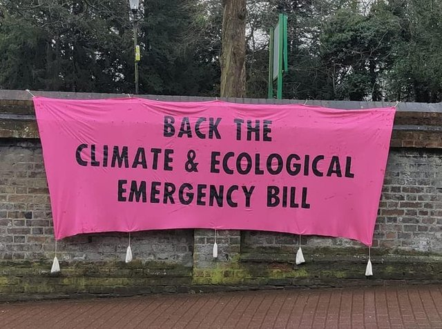 Volunteers supporting the Climate and Ecological Emergency Bill, hosted a banner in Tring