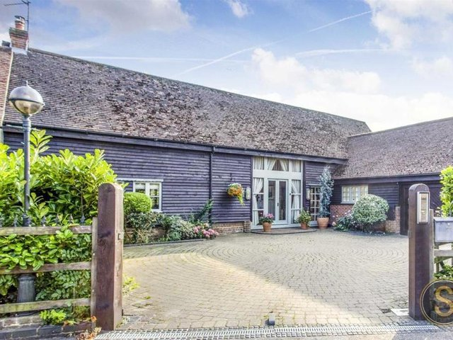 This five-bedroom barn conversion in Ashridgeis on the market