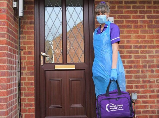A Rennie Grove nurse dressed in PPE