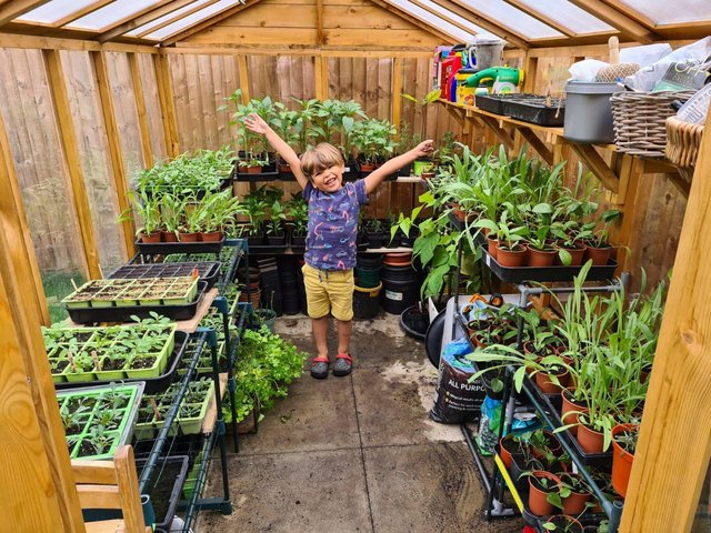 Four-year-old Douglas has been growing plants and vegetables in his garden