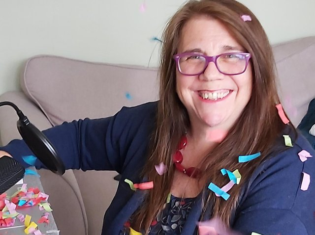 Kerry Brabant, founder of Herts Musical Memories celebrating the news as she finishes her online singing session