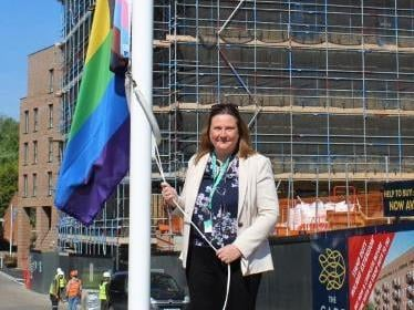 Council Chief Executive Claire Hamilton raises the flag for Pride Month