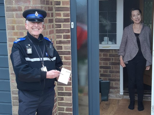 PCSO John Hainsworth with local resident, Jackie, signing up to OWL