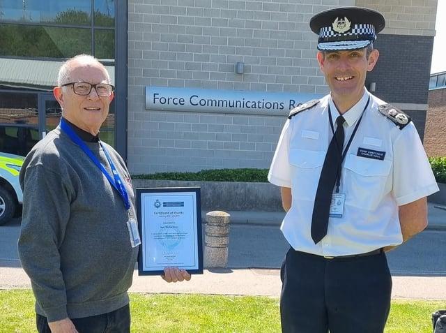 Volunteer Ben Richardson receiving his certificates from Charlie Hall