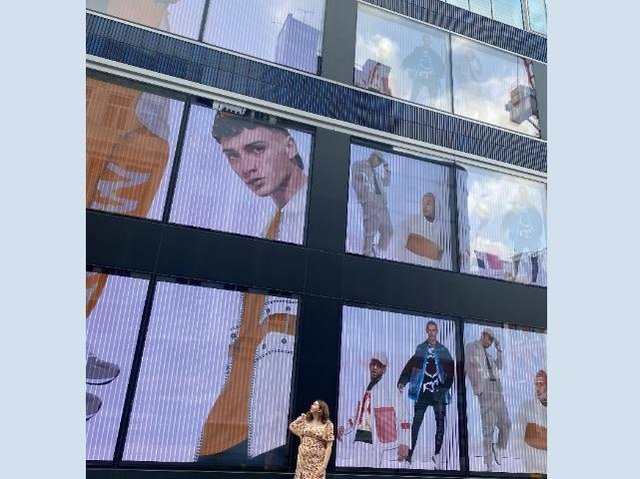 Angela in front of her work in Oxford Street