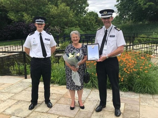 Superintendent Matt Phillips, Sue Thompson and Chief Constable Charlie Hall