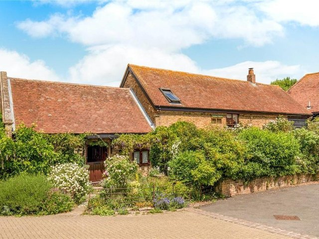 This five bedroom detached barn conversion in Gubblecote is on the market right now