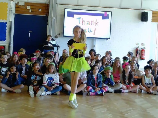 Year 5 doing their journey through the decades - they all dressed as someone from one of the decades